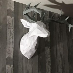 Deer low poly puzzle head on bedroom wall
