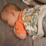 Baby snuggled up in Shared Canada Creatures blanket