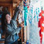 Justine hangs new glass artwork in window
